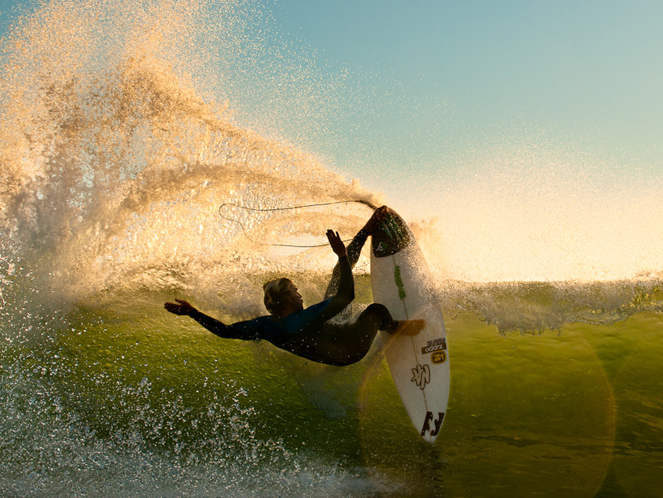 impressive surfer and wave splash