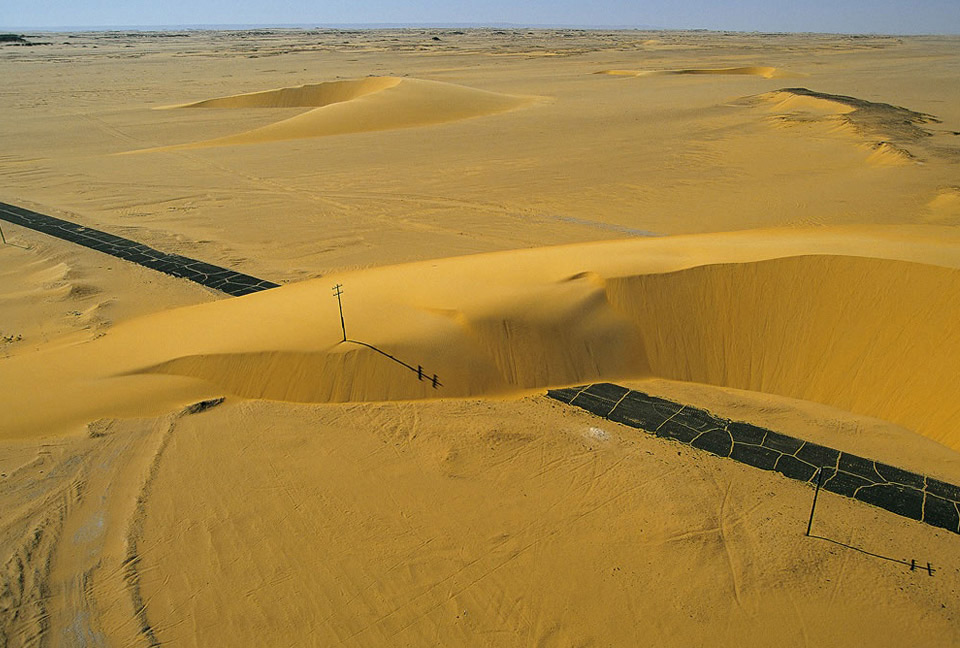 road-interrupted-by-a-sand-dune.jpg