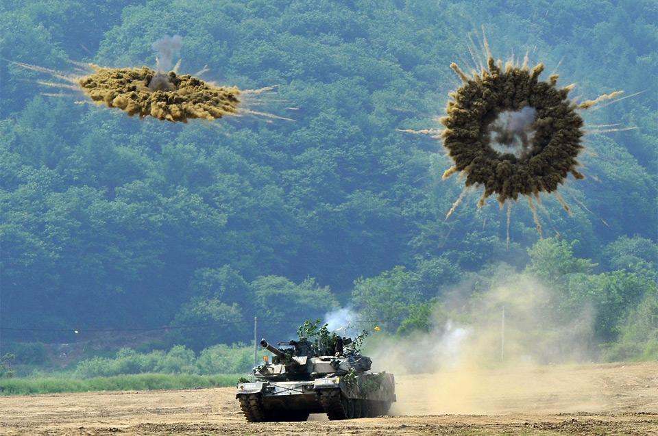 tank firing smoke shells