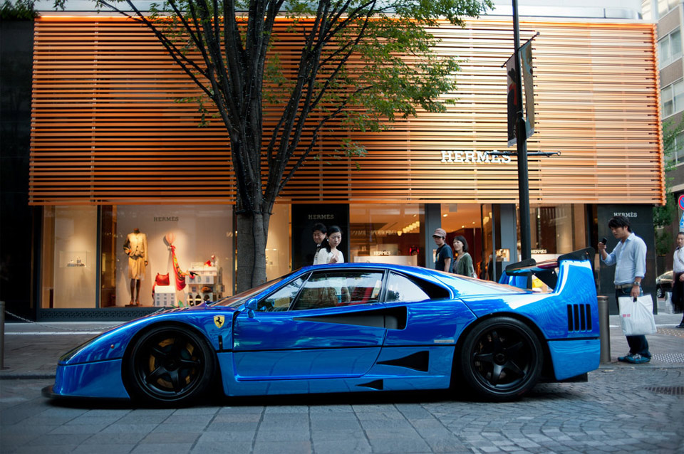 a beautiful blue ferrari f40