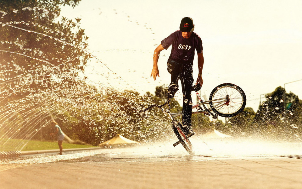 bmx skills over water sprinkler