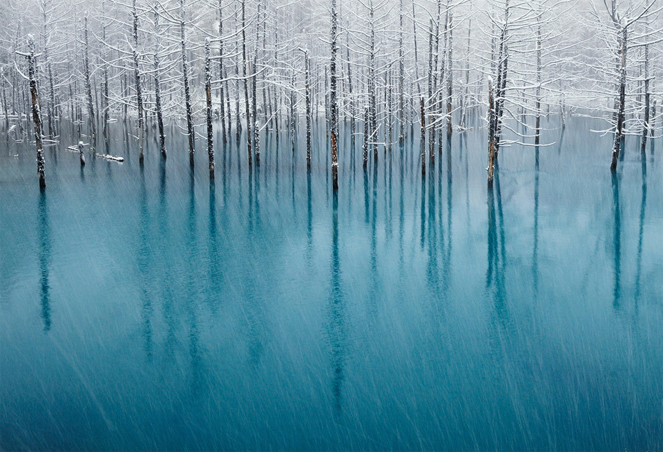 snow on a blue pond