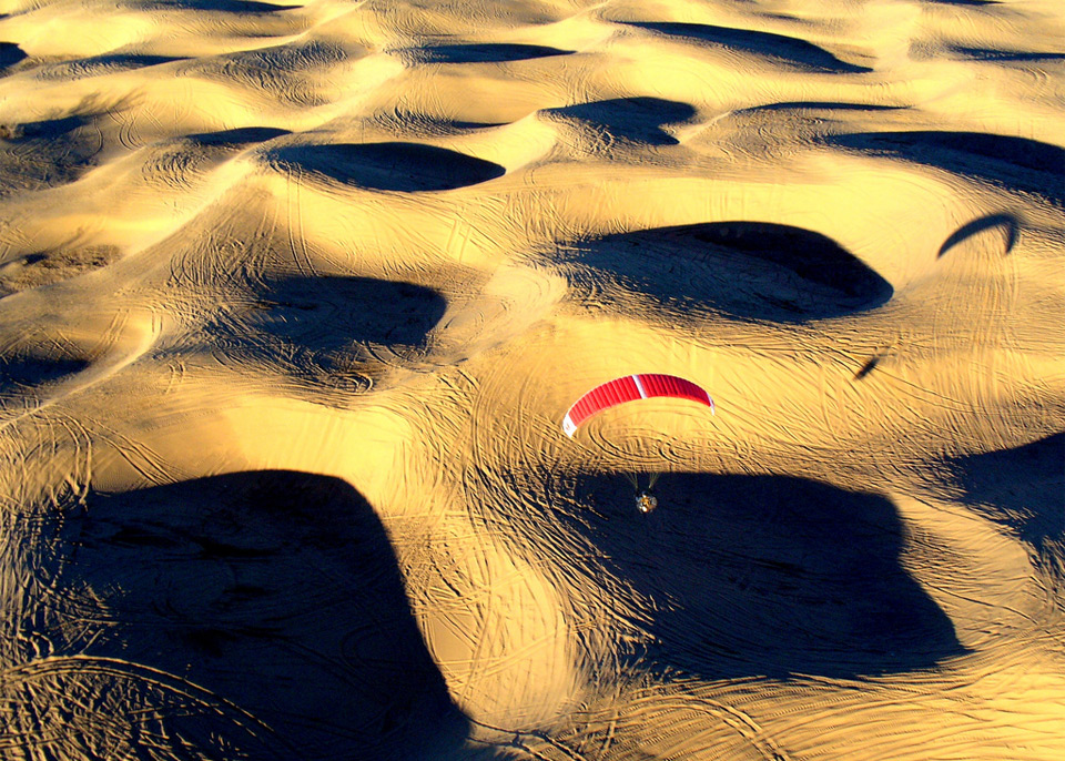paragliding over dunes