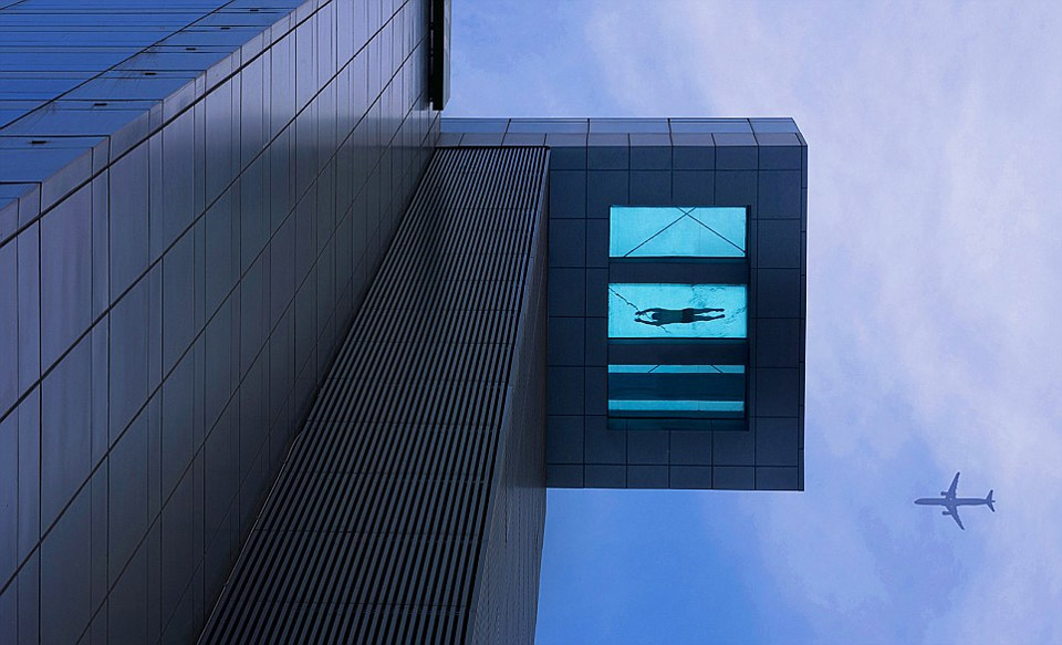 glass bottom swimming pool at 24th floor
