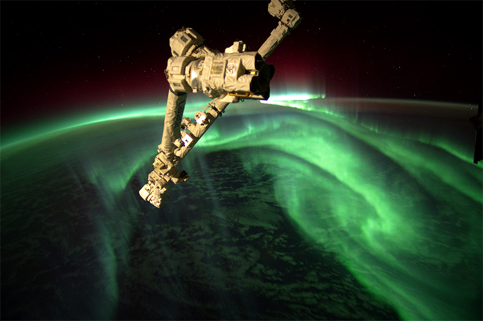 space station above aurora borealis