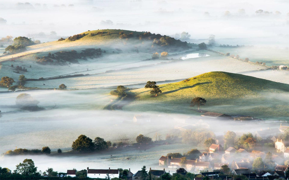 mist over countryside, england
