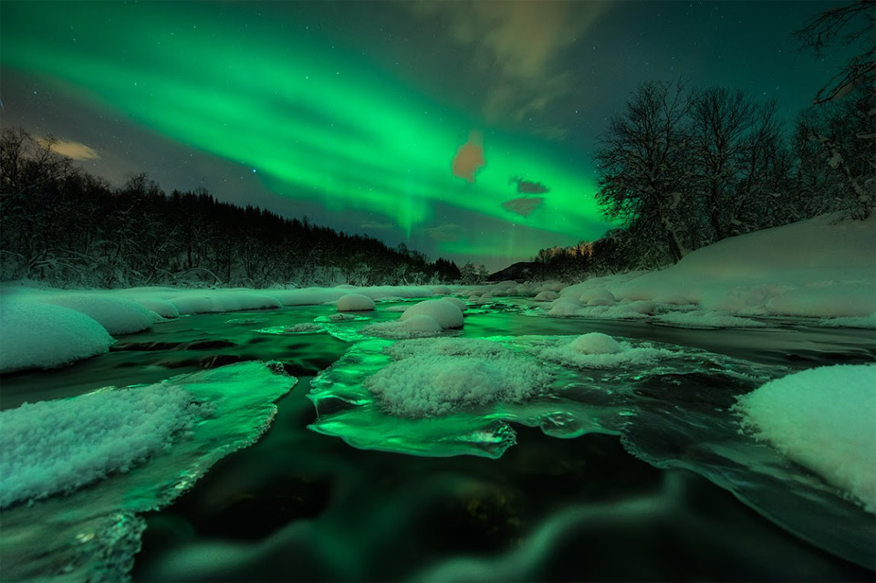 aurora shines over river, norway