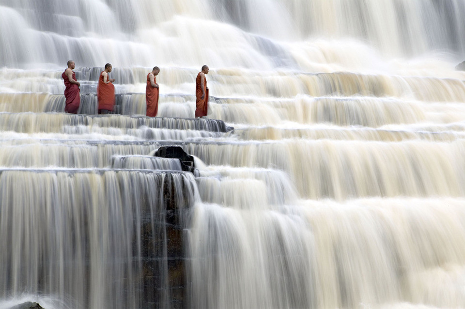 monks at pongour falls