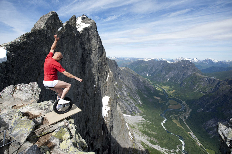 balancing on the edge of 1,000ft cliff in norway