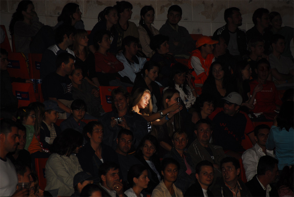 girl taking a photo of herself at concert