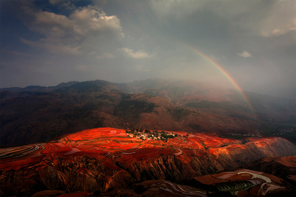 rainbow over red land, china