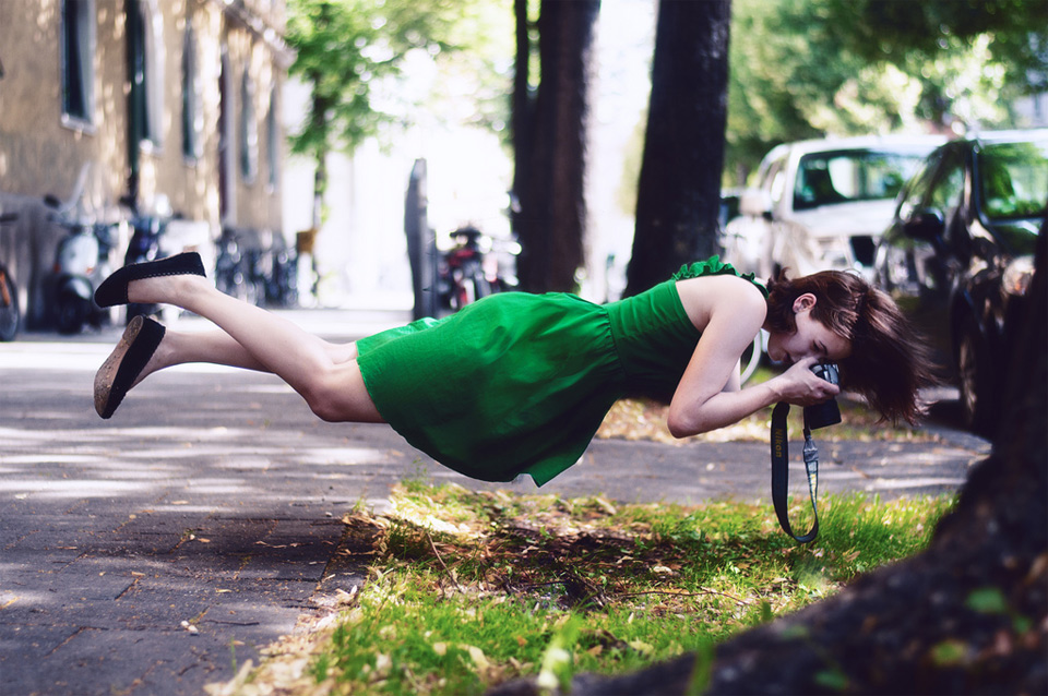 levitating girl takes photo