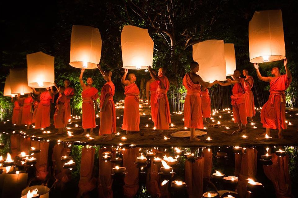 monks at loy krathong festival, thailand