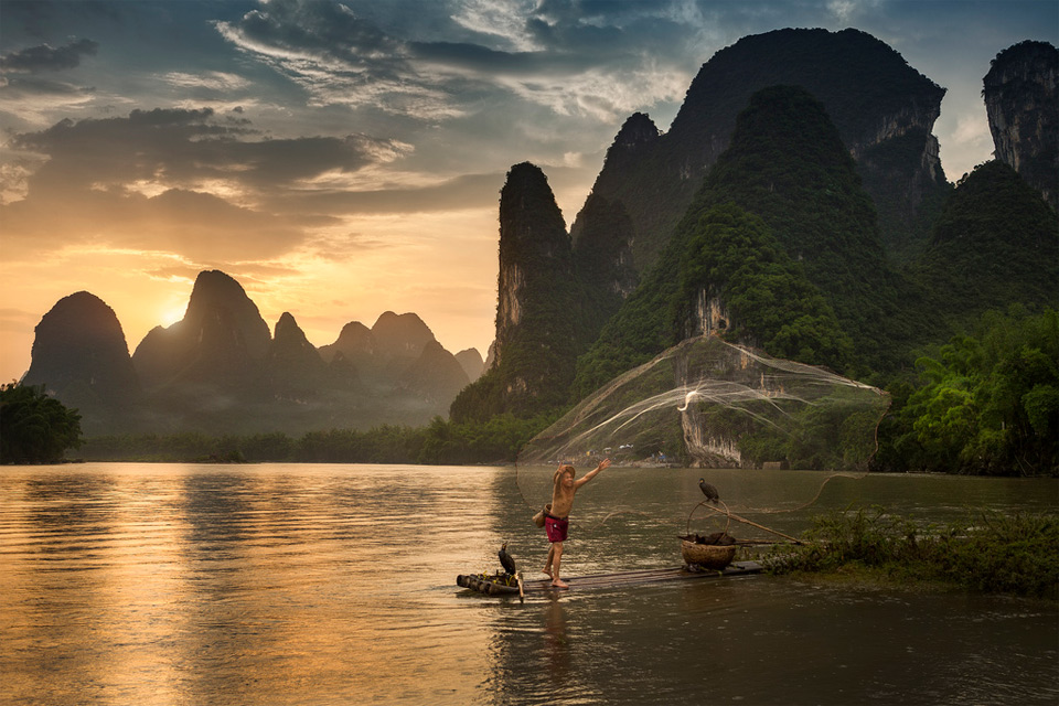 fisherman in xing ping village, china