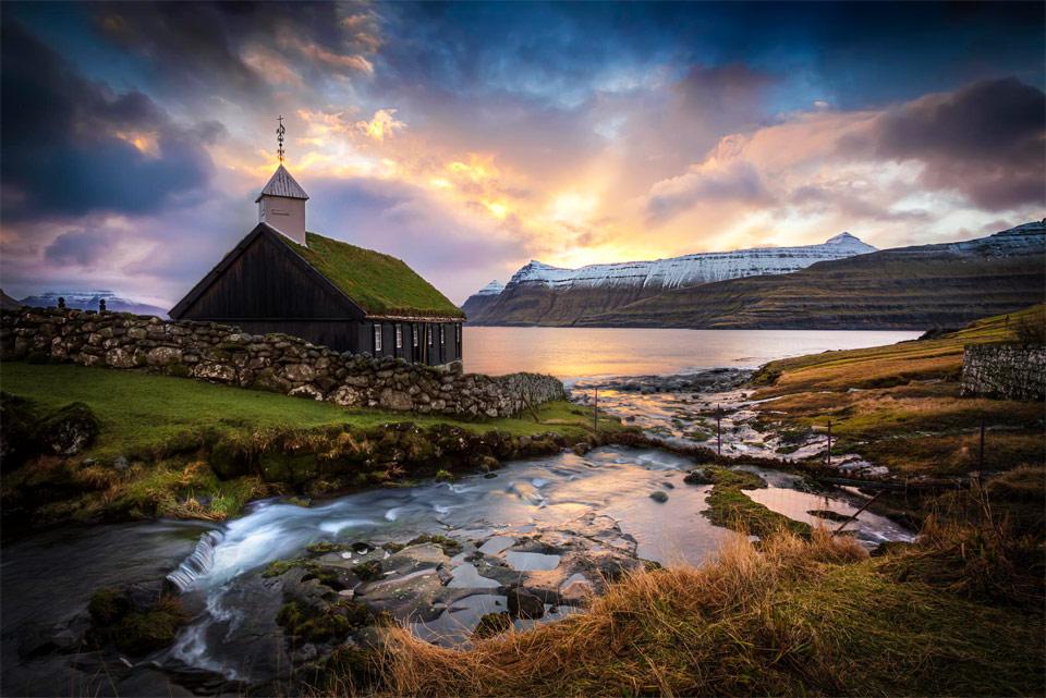 sunrise over church on the faroe islands