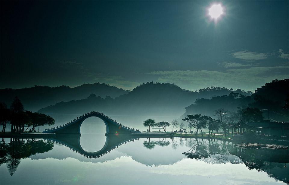 bridge over calm waters, china
