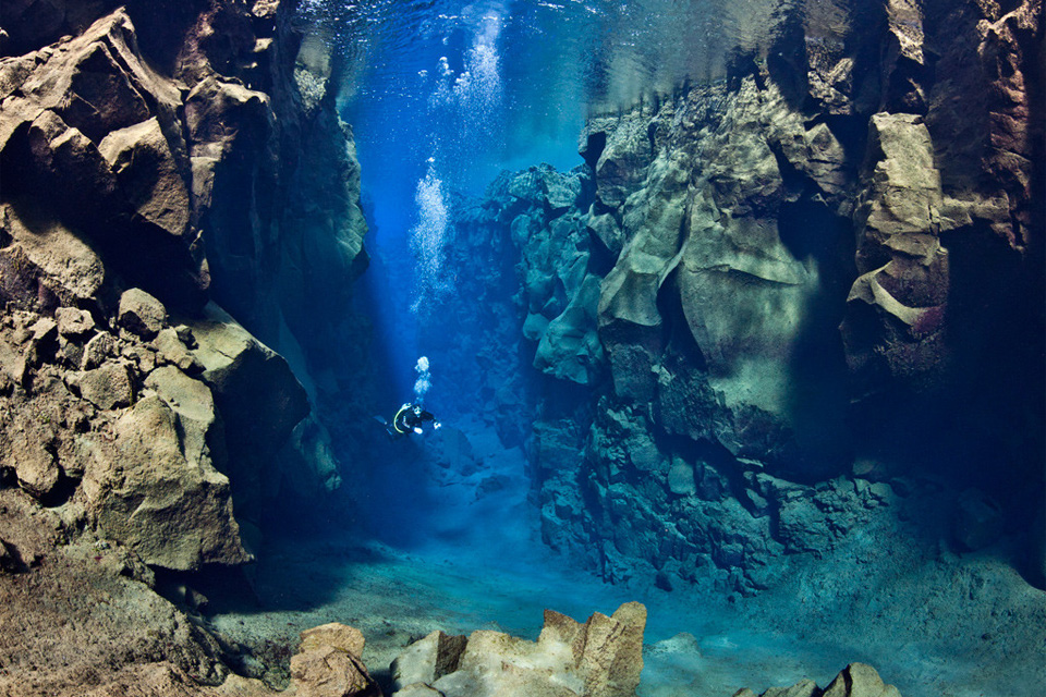 diver between two tectonic plates, iceland