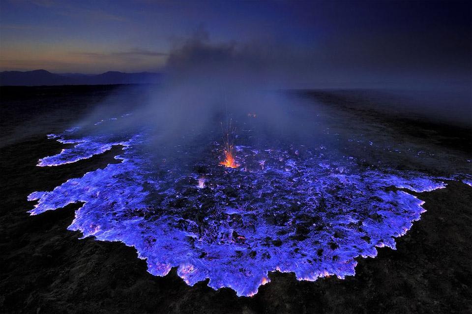volcano emits glowing blue liquid, indonesia