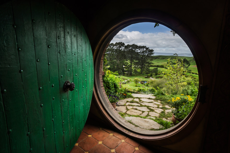 a view from inside inside hobbiton house, new zealand