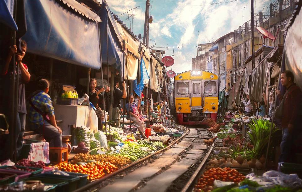 a train goes through market, bangkok
