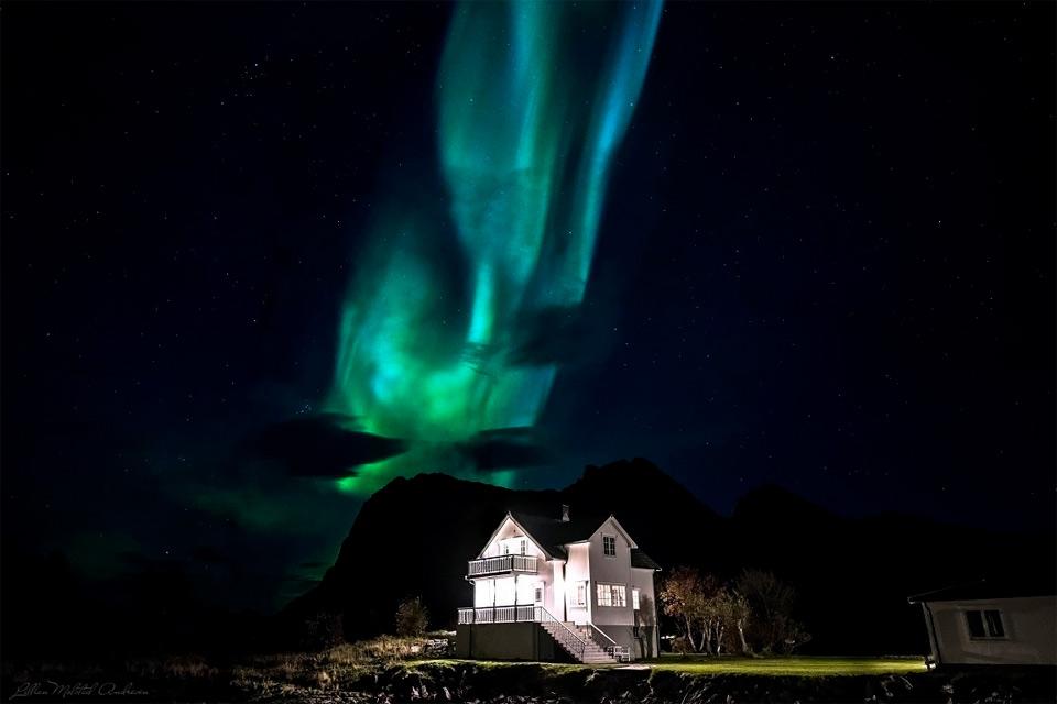 aurora borealis over house, norway