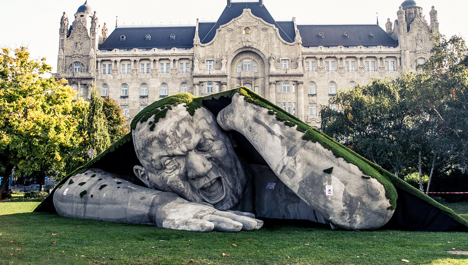 gigantic man crawls out from the earth sculpture, budapest