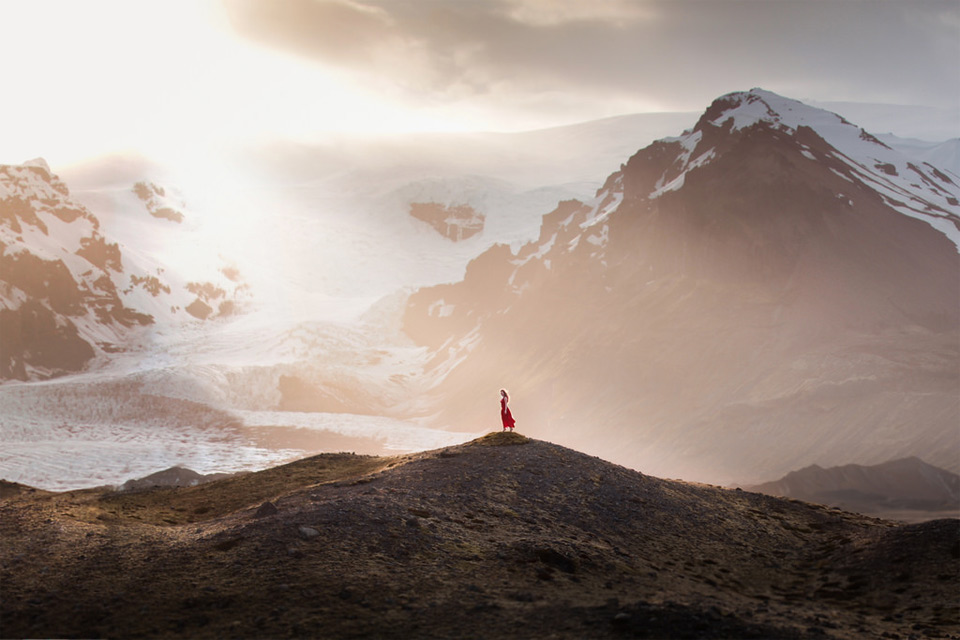 girl with red dress at iceland landscape