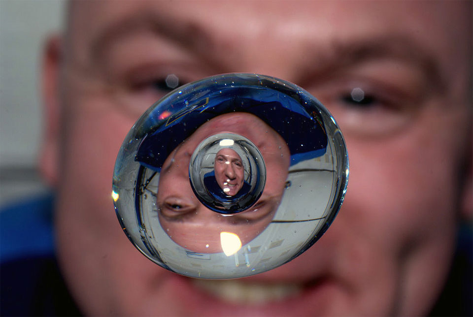 Astronaut Through Water Bubble