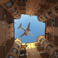 an airplane over buildings