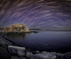 star trails over fort at la tour fondue, southern france