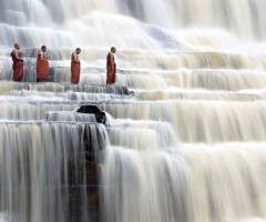 monks at pongour falls