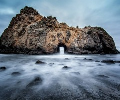 natural doorway, big sur beach, california