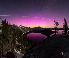 pink aurora over crater lake, oregon