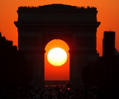 sunset in the middle of arc de triomphe, paris