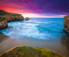 colourful sunrise over tunnel beach, new zealand