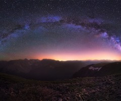 milky way above rocky mountains