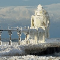 winter hits st. joseph lighthouse, michigan lake