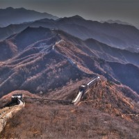 the great wall of china snakes through the mountains
