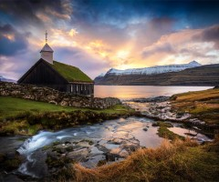 sunrise over church on the faroe islands