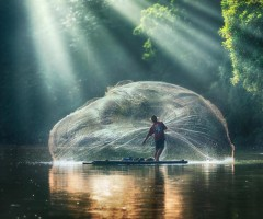 fisherman throwing his net photo