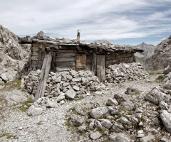 stone and wood mountain shack, austria