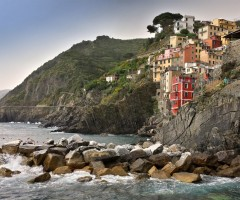 a village on cliff, riomaggiore, italy