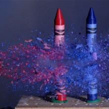 bullet through crayons, high speed photo