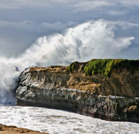 surfer cliff jump