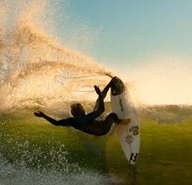 impressive surfer and wave splash