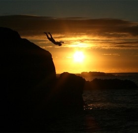 jumping into sunset