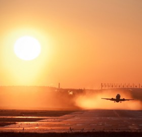 taking off at sunset