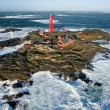 lighthouse island at winter storm