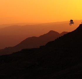 biker airs into a sunset