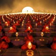 buddhist monks at a lantern lighting ceremony